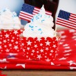 American patriotic holiday cupcakes and glass of cola on wooden table — Stock Photo #49559191