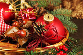 Christmas decorations in basket and spruce branches on table close up — Stock Photo