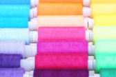 Multicolor sewing threads background — Stock Photo