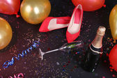 Shoes with confetti, champagne and balloons on the floor — Zdjęcie stockowe