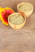 Dry henna powder in bowls on wooden table — Stockfoto