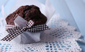 Chocolate muffin on color  wooden background — Stok fotoğraf