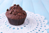 Chocolate muffin on wooden background — Stok fotoğraf