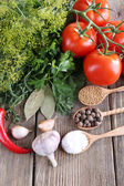Fresh vegetables with herbs and spices on table, close-up — Stock Photo