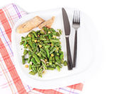 Salad with green beans and corn on plate, isolated on white — Stock Photo