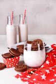 Milk cocktails in glasses and chocolate cookies  — Stock Photo
