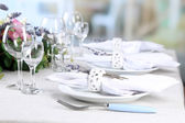 Dining table setting with lavender flowers on table, on bright background. Lavender wedding concept — Stock Photo