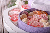 Present box with sweets close up — Stock Photo