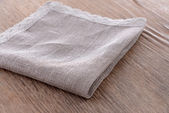 Napkin on wooden table, close-up — Stock Photo