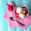 Creamy ice cream with raspberries on plate in glass bowl, on color wooden background — Stock Photo #49764915