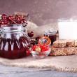 Berries jam in glass jar on table, close-up — Stock Photo #49765279