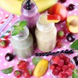 Bottles of delicious smoothie on table, close-up — Stock Photo #49766027