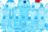 Water in different bottles — Stock Photo