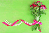 Beautiful bouquet with ribbon — Stock Photo