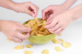 Hands of people take chips from bowl — Stock Photo