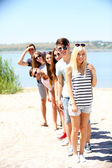 Beautiful young people on beach — Stock Photo