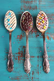 Spoons with tasty chocolate — Stock Photo