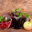 Glasses of fresh beet juice and vegetables on wooden background — Stock Photo #49776499