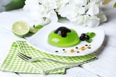 Green jelly with blackcurrant berries — Stock Photo