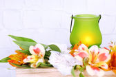 Bright icon-lamp with flowers on wooden ladder on light background — Stock Photo