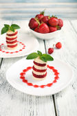 Fresh strawberry with banana on skewers on plate on light background — Foto Stock