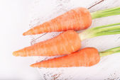 Fresh carrot on wooden stand  — Photo
