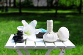Herbal remedies for massage on table, outdoor  — Stock Photo