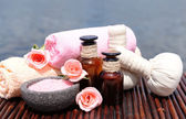 Herbal remedies for massage on bamboo mat, outdoor  — Stock Photo