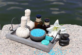 Herbal remedies for massage, on wooden tray, outdoor  — Photo