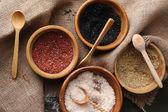 Different sea salt in bowls, close up — Stock Photo
