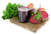 Glass of fresh beet juice and vegetables on cutting board isolated on white — Stock Photo