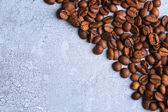 Coffee beans on color wooden background — Stock Photo