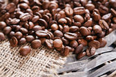 Coffee beans on wicker mat background — Stock Photo