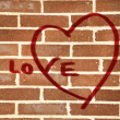 Graffiti heart on brick wall — Stock Photo #49815059