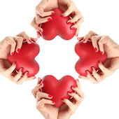 Red hearts in woman hands — Stock Photo