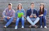 Happy students in park — Stock Photo
