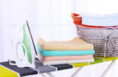 Baskets with laundry and ironing board — Stock Photo