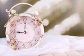 Alarm clock with flowers — Stock Photo