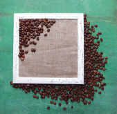 Wooden frame and coffee grains — Stock Photo