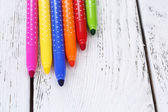 Bright markers on table — Stock Photo