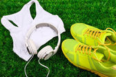 Sport clothes with shoes and headphones — Stock Photo
