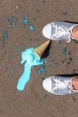 Ice cream fell on asphalt top view — Stock Photo