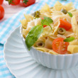 Delicious pasta with tomatoes on plate on table close-up — Stock Photo #49844633