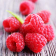 Ripe sweet raspberries on table close-up — Stock Photo #49847405