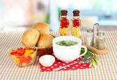 Fragrant soup in cup on table in kitchen — Stock Photo