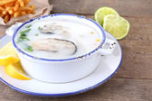 Tasty soup with oysters — Stock Photo
