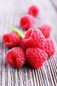 Ripe sweet raspberries on table close-up — Stock Photo