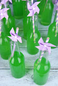 Bottles of drink with straw — Stock Photo
