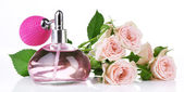 Perfume bottle with roses isolated on white — Stock Photo