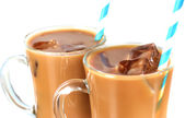 Glasses of iced milk coffee on light background — Stock Photo